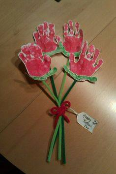 Idea to make flowers from paper handprint for kids 2