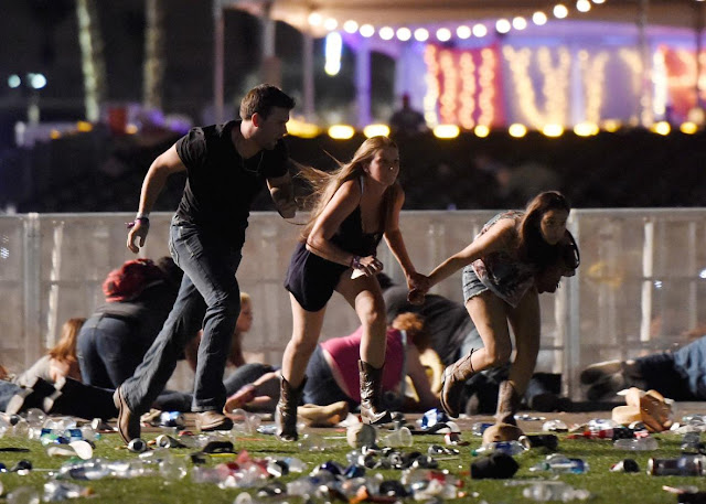 Image Attribute: Mass Shooting occurred at the Route 91 Harvest country music festival on the Las Vegas Strip in Paradise, Nevada. At least 59 people were killed and hundreds injured when a gunman opened fire at a country music festival. (October 1, 2017) / Source: David Becker/Getty Images