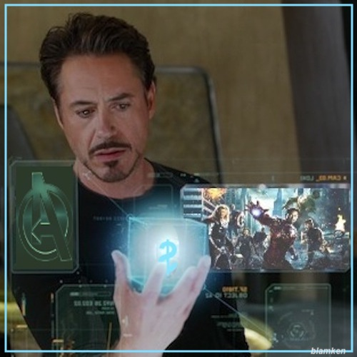 photo-illustration of Robert Downey Jr. as Tony Stark holding Cosmic Cube with dollar sign amidst viewscreens depicting Avengers promotional images