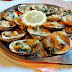 Delicious French butter & garlic baked fresh clams with Parmesan & breadcrumb crust