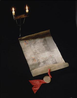 Vanhan näköinen kääro, jossa on tekstiä.