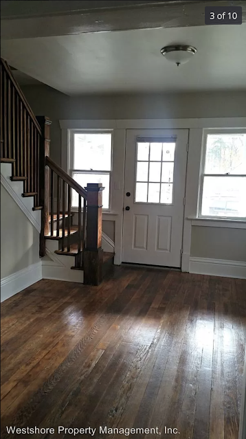 color interior photo of living room, doorway, windows, staircase Sears Norwood model 230 Strong Avenue Muskegon MI