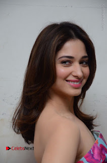 Actress Tamanna Latest Images in Floral Short Dress at Okkadochadu Movie Promotions  0117.JPG