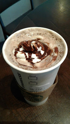 Starbucks Venti Hot Mocha with whip cream and chocolate drizzle