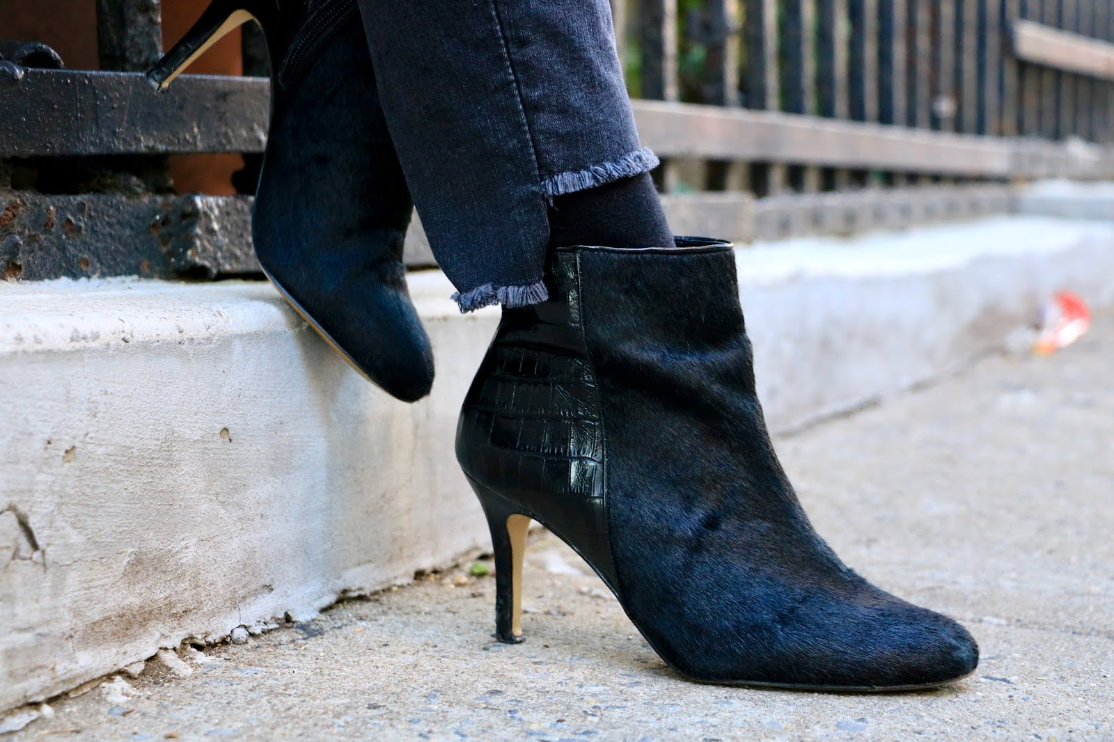Nyc fashion blogger Kathleen Harper wearing leather and calf hair black boots from Ann Taylor.