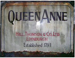 Original Queen Anne advertising panel in rusted state