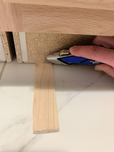 Using shims to install cabinets