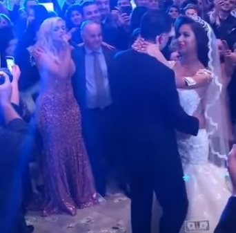 Bebe Rexha singing in an Albanian Wedding