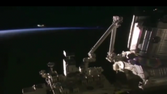Unbelievable UFO in silver is recorded visiting the International Space Station on live TV.