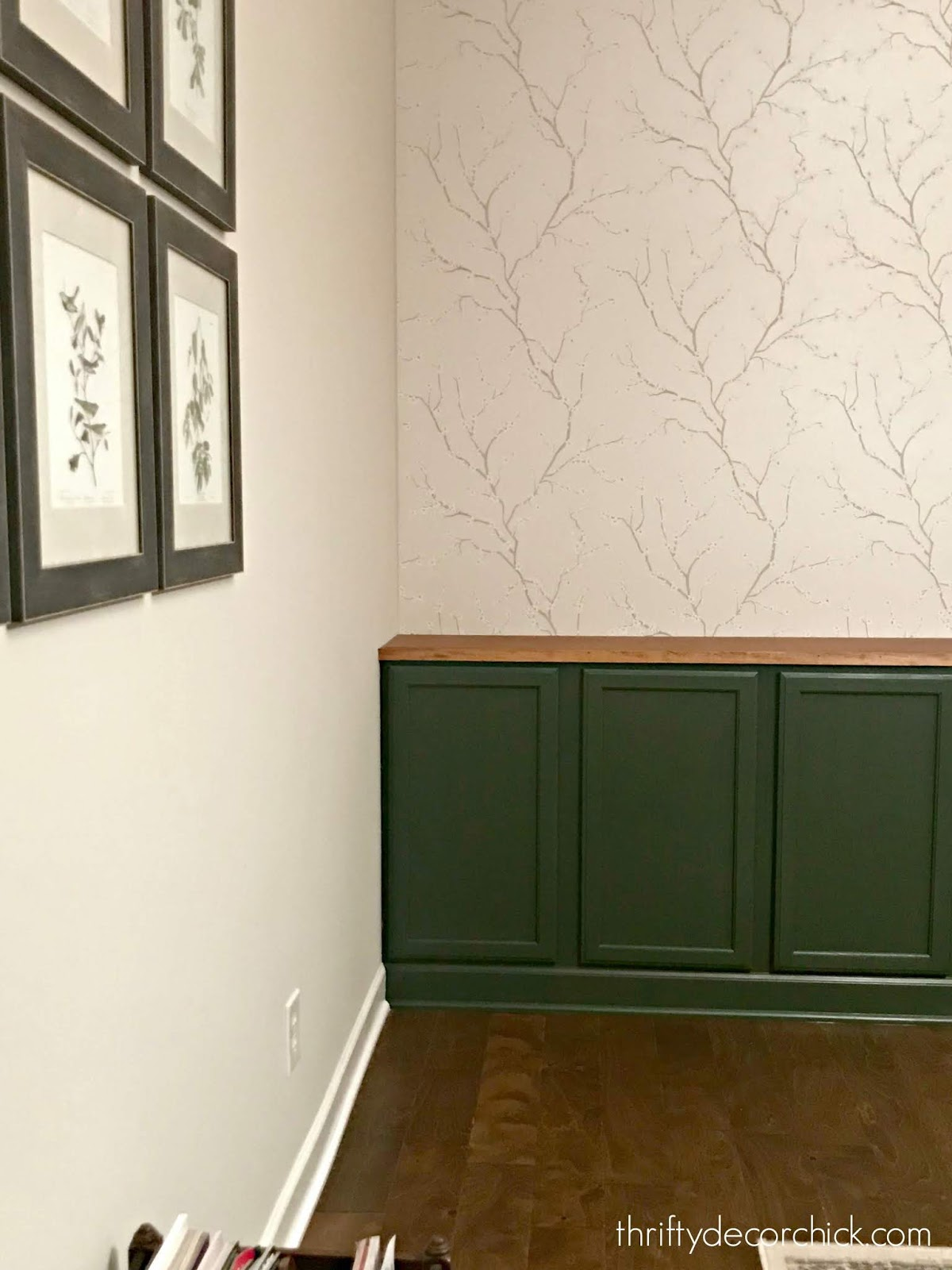 Dark green built in cabinets with wood top