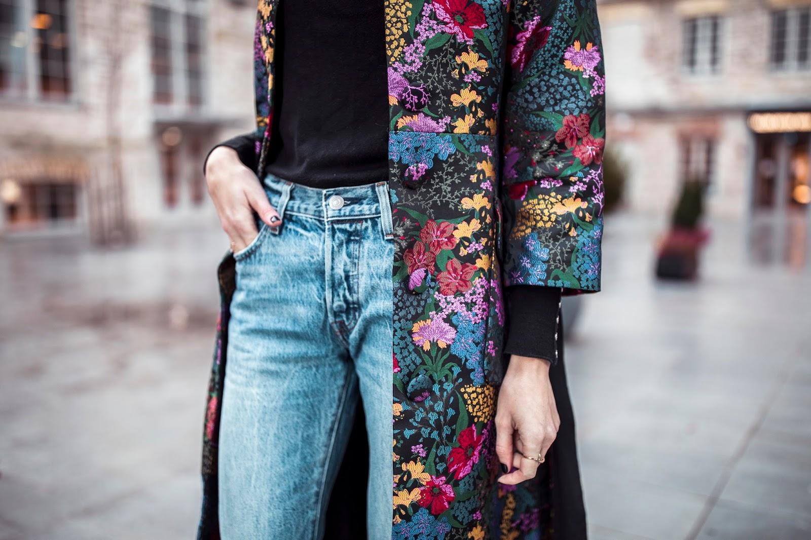 floral coat blue jeans