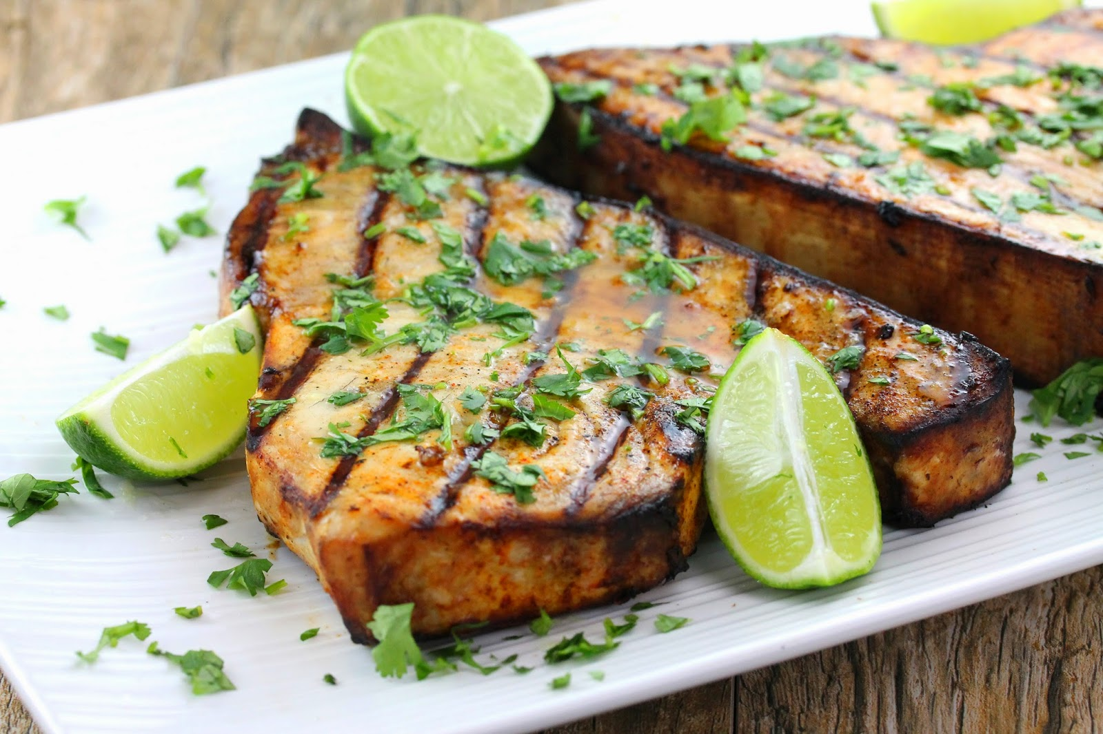 cilantro lime grilled swordfish on a white platter