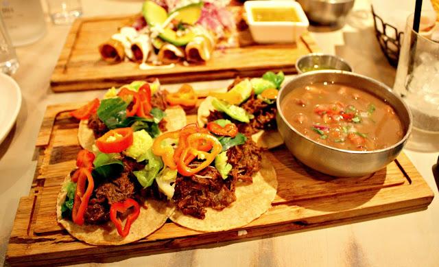 Vibrant vegetables and tender short rib tacos at Mesa Urbana.