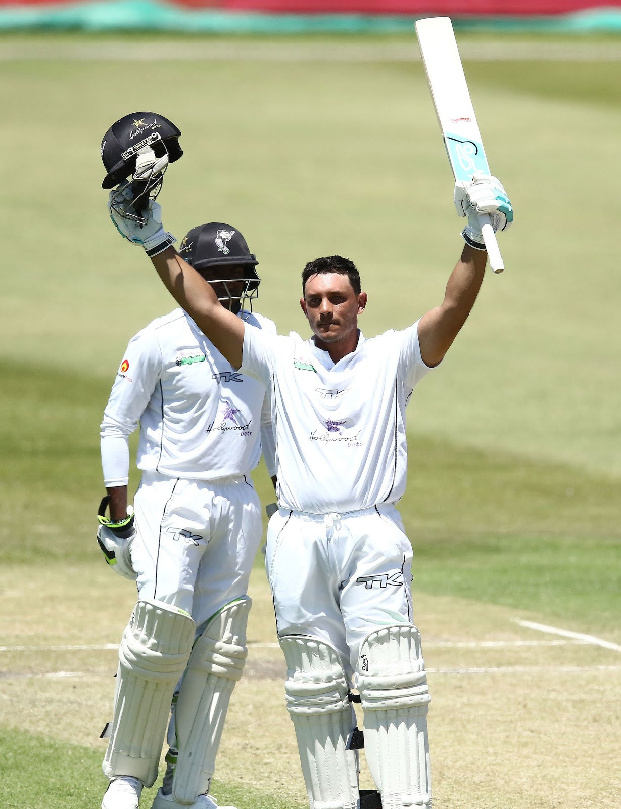 Vaughn van Jaarsveld lifts his bat to celebrate his ton