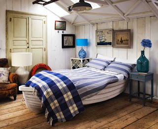 unique bedroom with nautical theme decorating white wood ship bed on brown wood floor plus blue table lamp