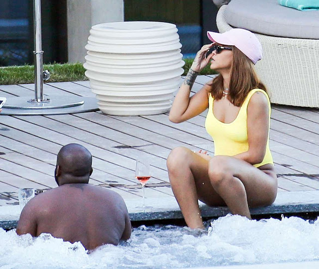 Rihanna in Yellow Swimsuit at a pool in Zurich