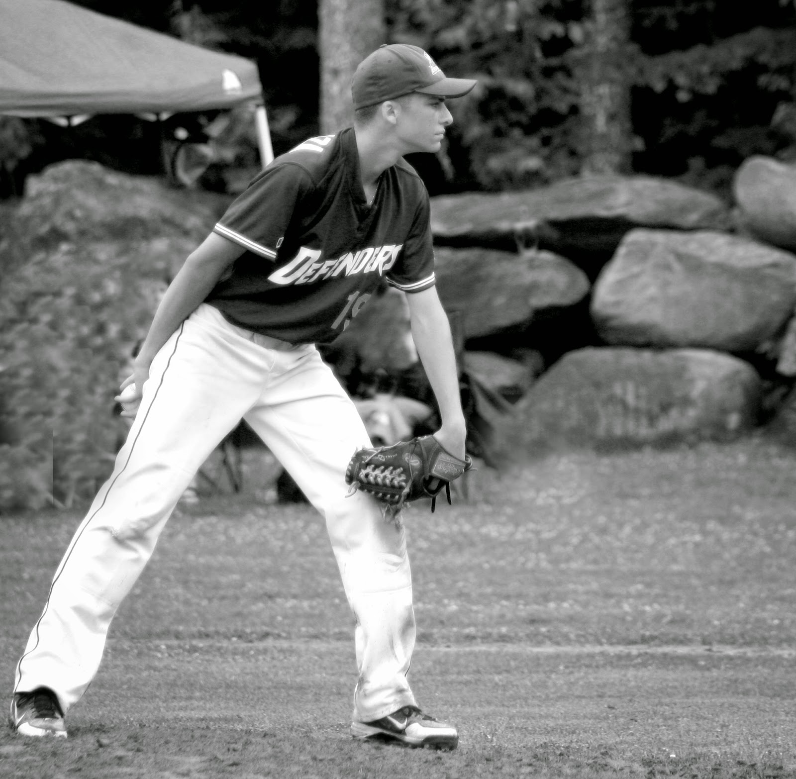 Baseball pitcher intense, focused on the game he is pitching