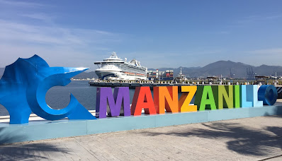 Manzanillo, Mexico sign with cruise ship in the background