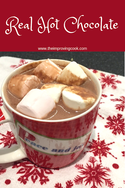 Hot chocolate in a Christmas mug with marshmallows on top