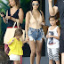 Kourtney Kardashian wears sexy lace-up swimsuit and Daisy Dukes for boat trip with Penelope and Mason (photos)