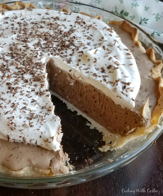 close up of a slice missing out of a chocolate french silk pie