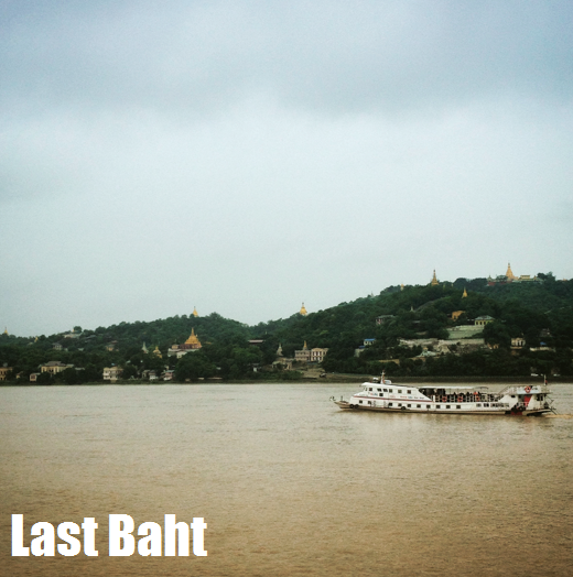 a river boat moves slowly through the brown waters of the Irawaddy river past green hills dotted with golden pagodas