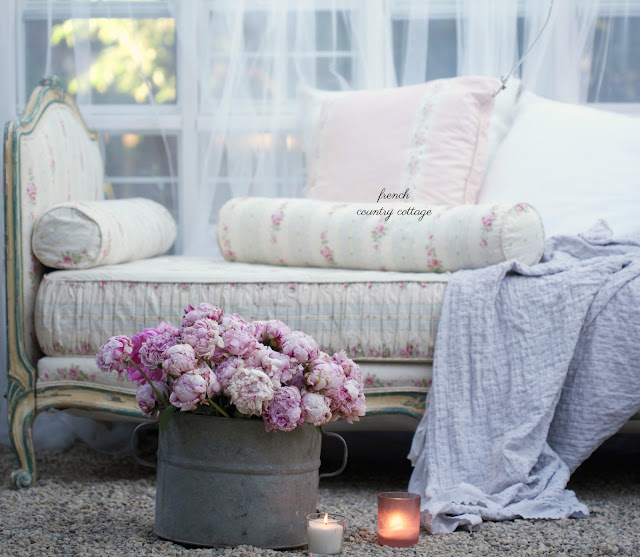 vintage french daybed with bucket of peonies