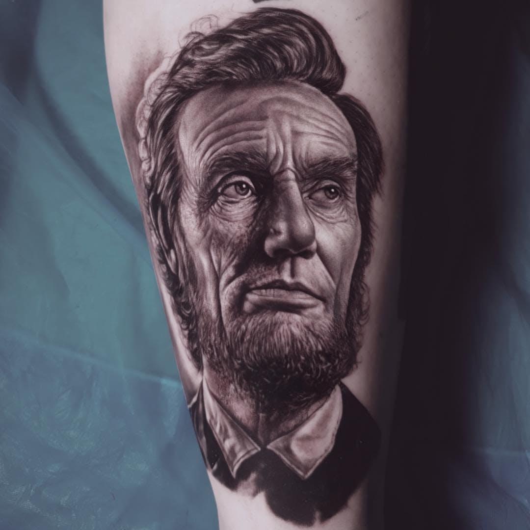 Tatuaje de Abraham Lincoln por Ralf Nonnweiler