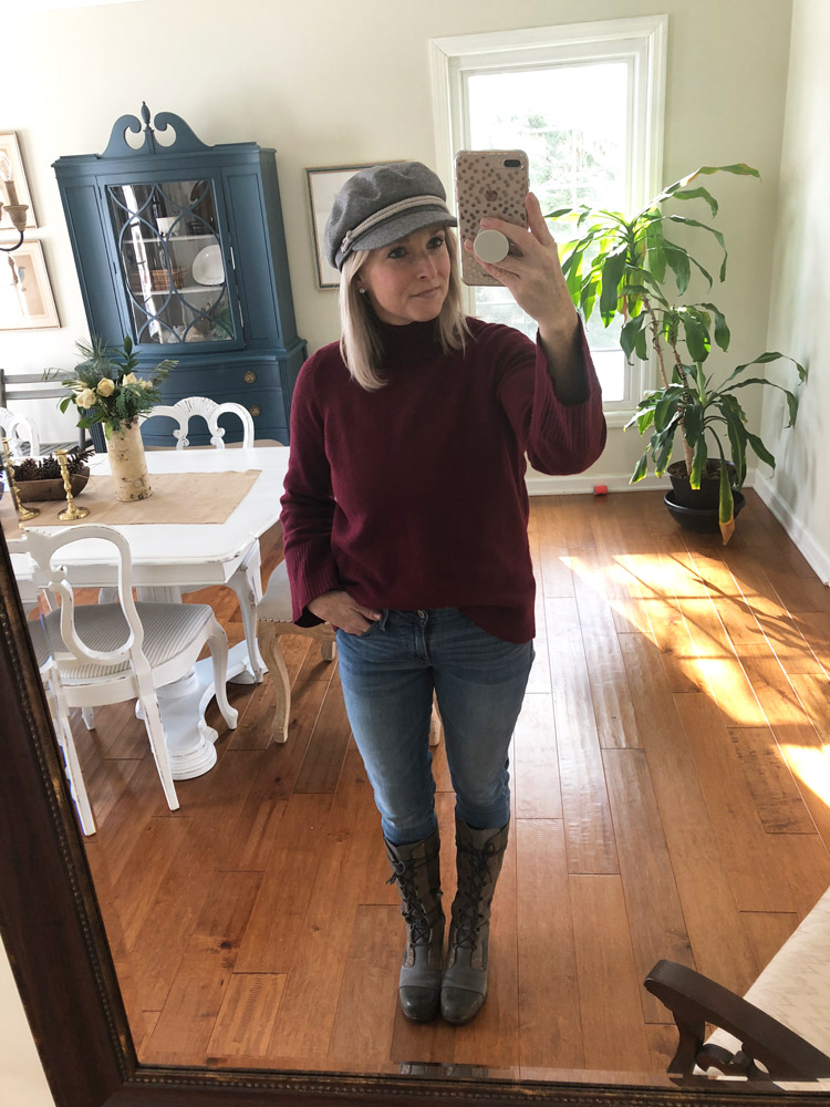 burgundy bell sleeve sweater with skinny jeans and sorel boots