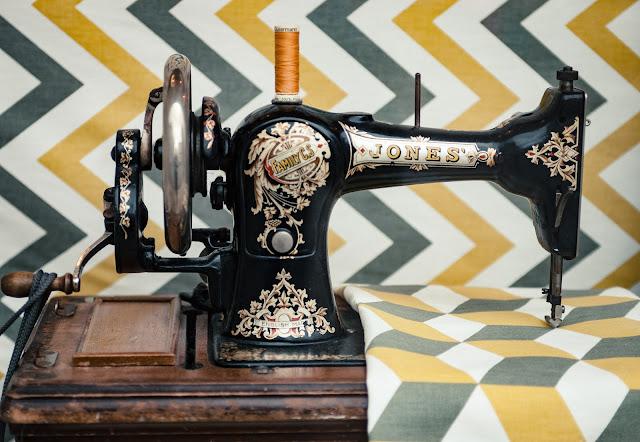 vintage sewing machine on chevron background Photo by Clem Onojeghuo on Unsplash