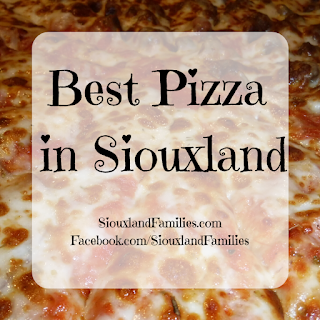 "in background, a cheesy pizza, in foreground ""Best Pizza in Siouxland"" and ""SiouxlandFamilies.com Facebook.com/SiouxlandFamilies"""
