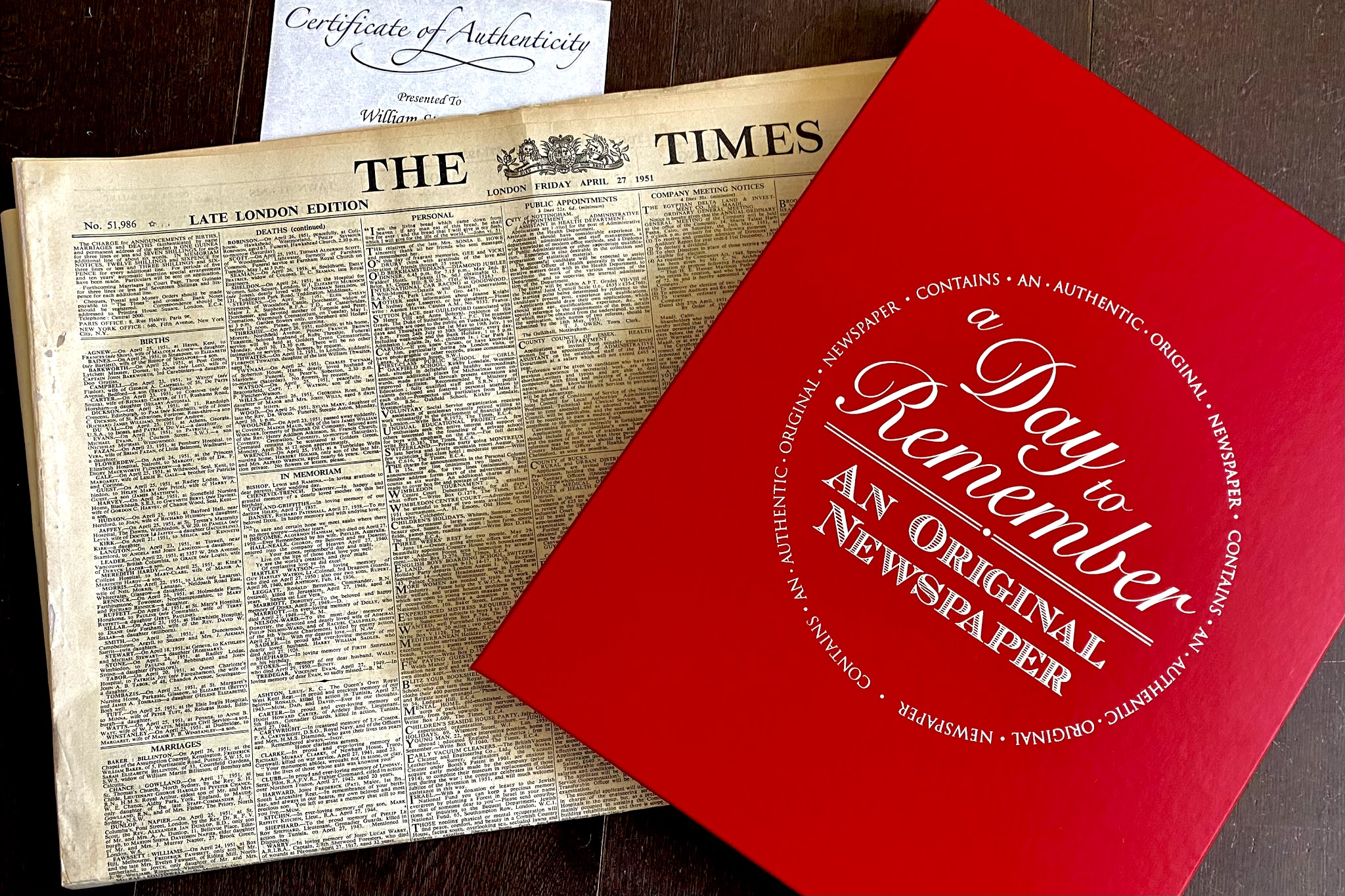 An original copy of The Times newspaper next to a gift box received for a 70th birthday present from Historic Newspapers