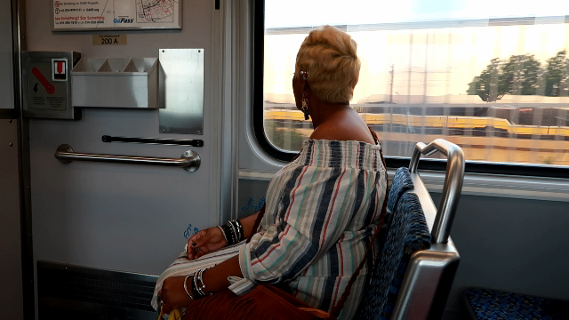 Image: Woman Tangie Bell riding the bus through Dallas Texas. Sharing her four month journey. Morning Babbles