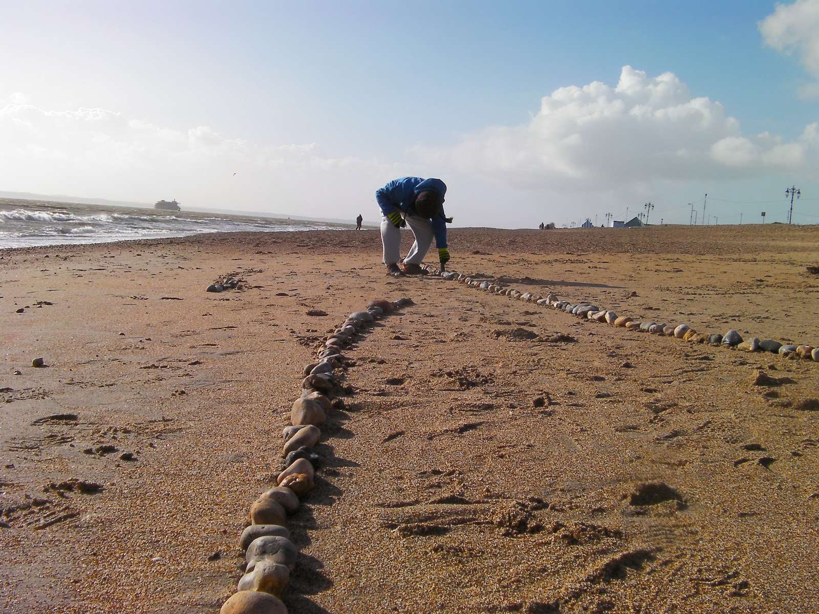 southsea beach with shingle stones washed away by stormy weather