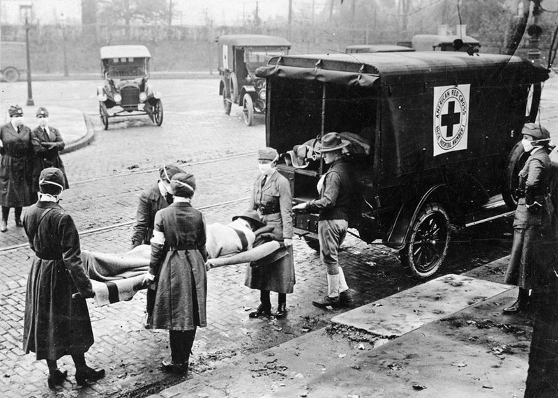 Red Cross workers transport a victim in St. Louis, Missorui
