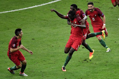 Portugal Players celebrating after Eder score the winner goal