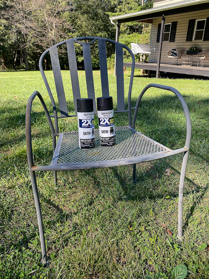 Spray painting old iron patio chairs