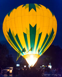 Cramer Imaging's fine art photograph of a hot air balloon glow at night in the streets of Panguitch Utah
