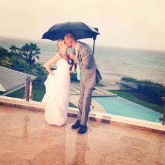 couple getting married in the rain