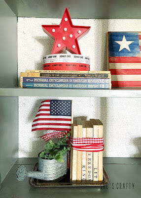 Last minute 4th of july decorating ideas -gray cabinet shelves vignette- patriotic books, stars, flag, stamped books