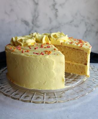 round lemon velvet cake with slice missing