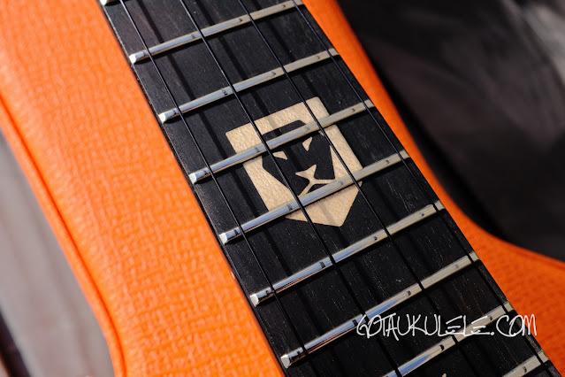 aNueNue Lion Orange UT Ukulele Lion logo