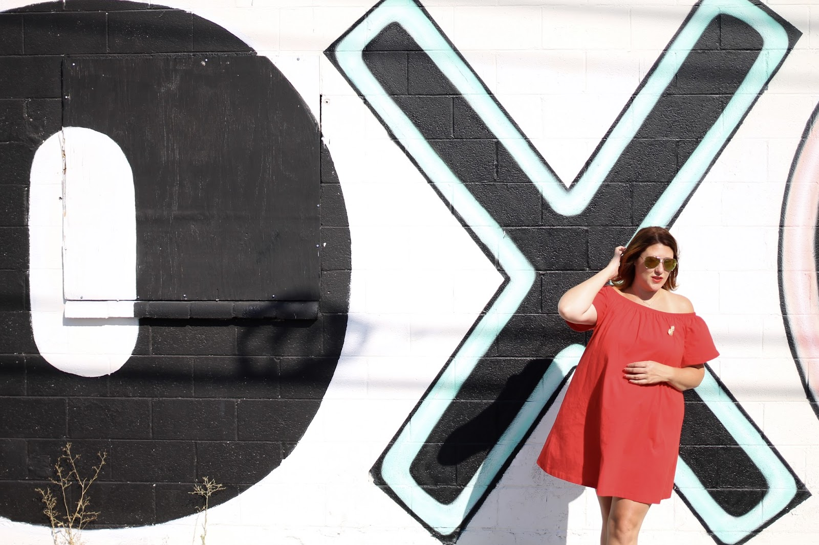 Las vegas mural, off the shoulder dress, converse. raybay aviators, red hair, easy maternity outfit