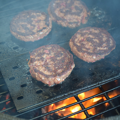 GrillGates protect the burger patties from burning when the dripping grease flares the flames.