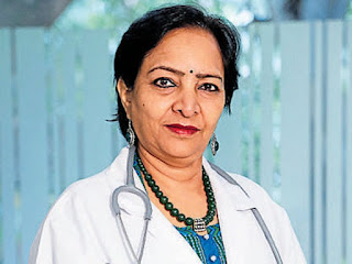 Dr. Kamini Rao, a gynaecologist, standing wearing a white coat and stethescope around her neck.
