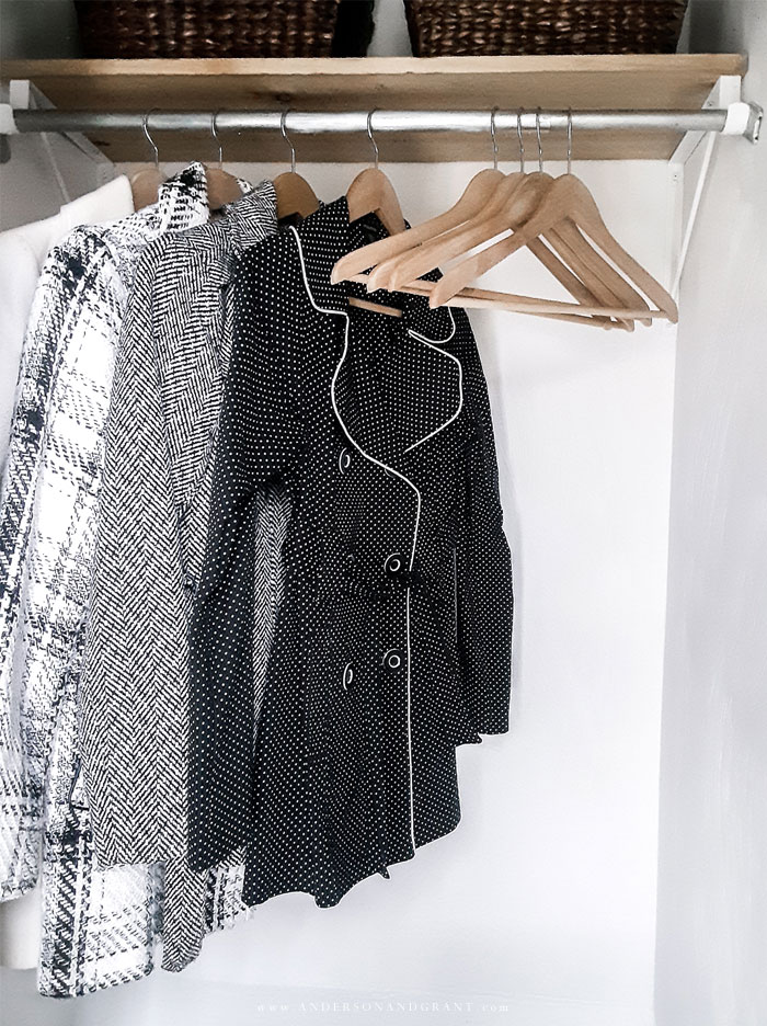 Closet with coats and hangers