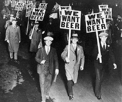 "Men protesting Prohibition with signs stating ""We Want Beer""."