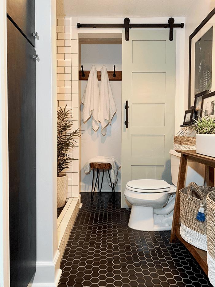 black hexagon tile bathroom mint door