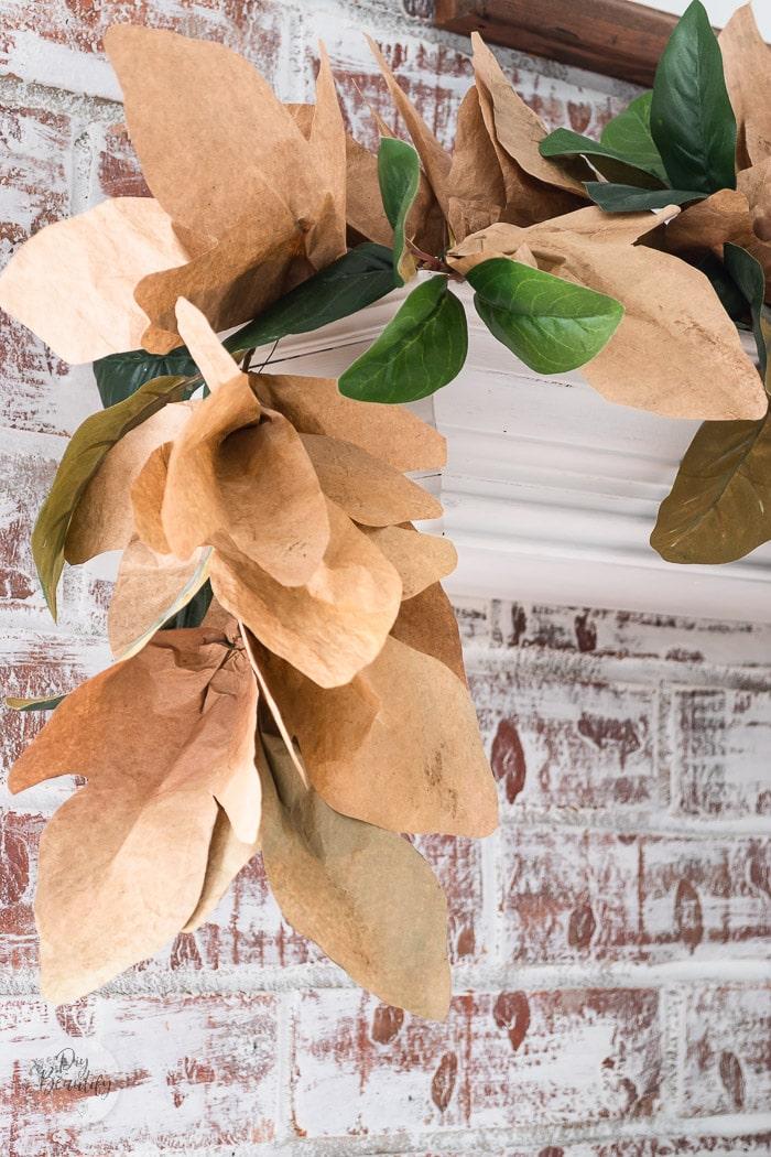 paper bag leaf garland on mantel
