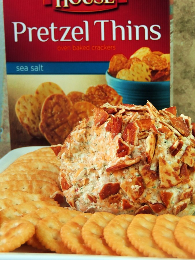 Buffalo Ranch Cheese Ball on a white platter with pretzel chips
